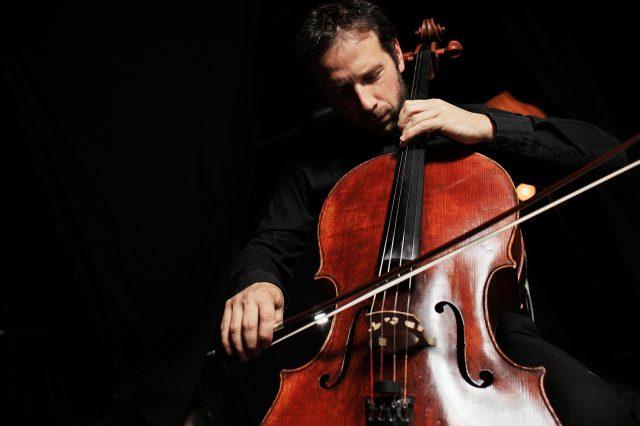 cello teacher performing